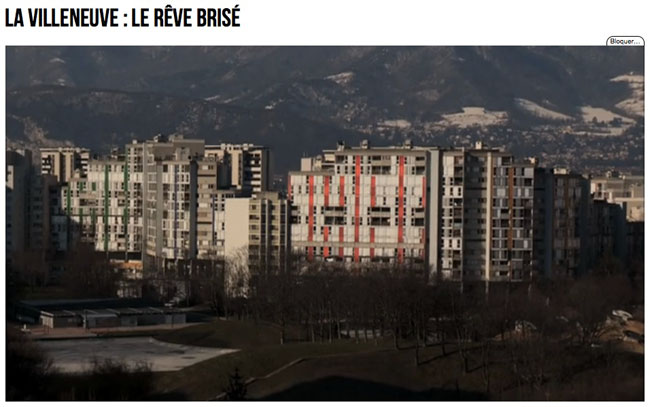 Vue générale des immeubles avec les montagnes dans le reportage Envoyé Spécial Villeneuve le rêve brisé diffusé sur France 2