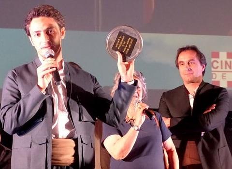 De gauche à droite : le réalisateur Berni Goldblat, Zanyar Azizi, sa traductrice et Nicolas Tixier, président de la Cinémathèque de Grenoble. © Alexandra Moullec