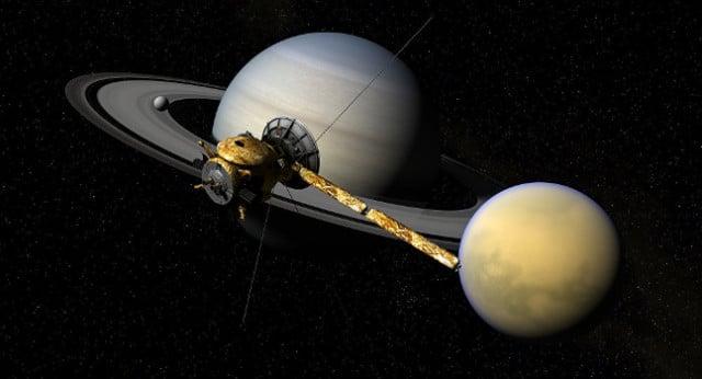 La sonde Cassini et Titan en orbite autour de Saturne. Illustration. – DR
