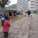 Quartier Jean Macé à Grenoble, une trentaine de familles de demandeurs d'asile massés sur le terrain pollué du parc Henri-Tarze, depuis trois mois pour la plupart d'entre eux. dimanche 27 octobre © Séverine Cattiaux - Place Gre'net
