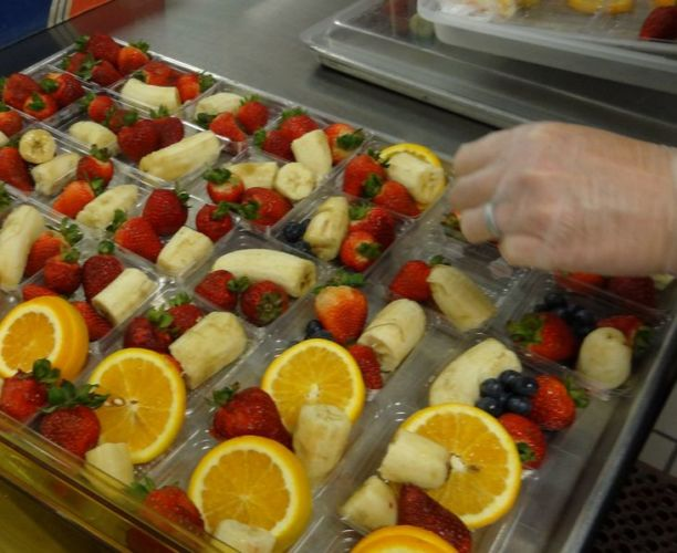 Fruits in plastic trays on table in Whitley County School District, KY. © US Department of Agriculture