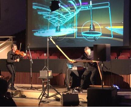 « Duel for strings» à Agora creative. Une performance de Ricardo Climent et Philippe Wucher. © Joël Kermabon - Place Gre'net
