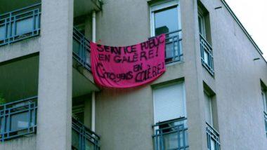 Une banderole accrochée à des fenêtre ce 1er mai 2020. © Anissa Duport-Levanti
