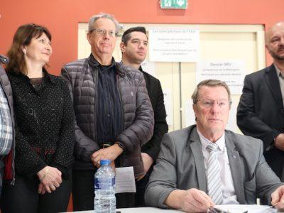 Le maire de Sassenage Christian Coigné entouré de son équipe